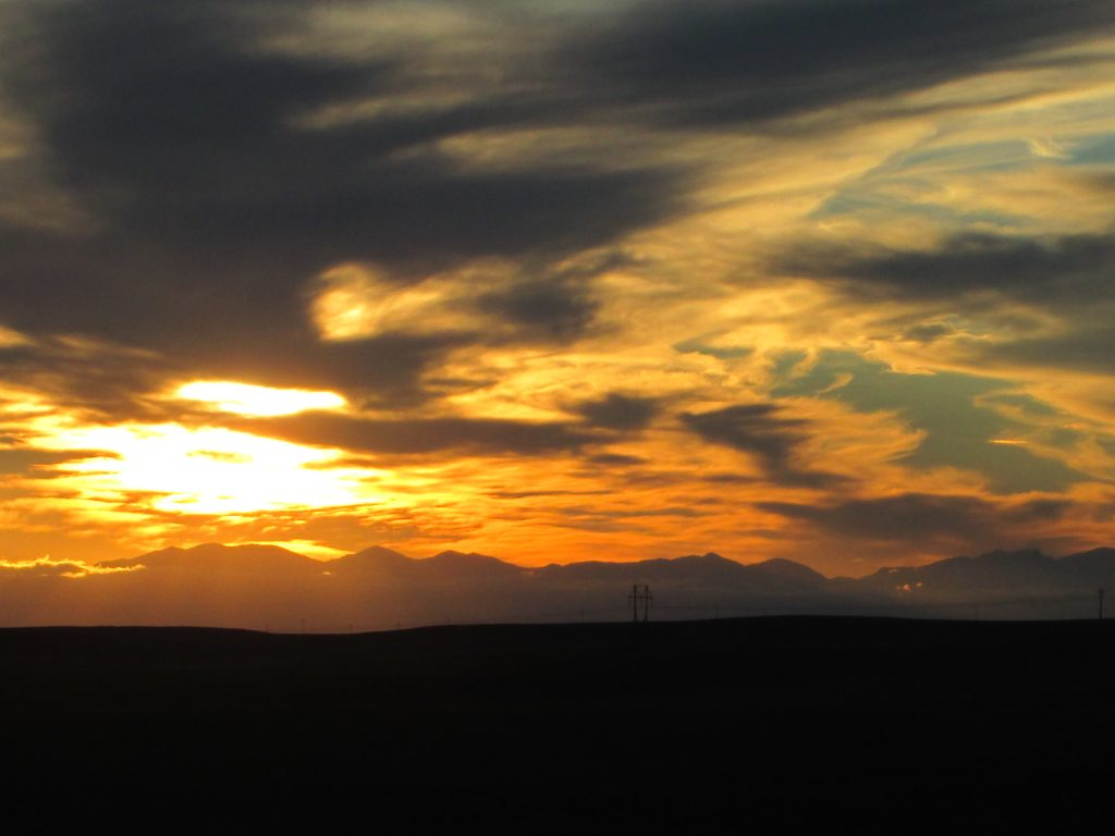 A surreal sunset over the Bighorn Mountains of Wyoming, illustrating the author's love of both travel and photography.