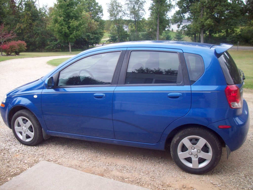 Blue Chevy Aveo hatchback in nice condition, a vehicle upgrade for the author and his wife.