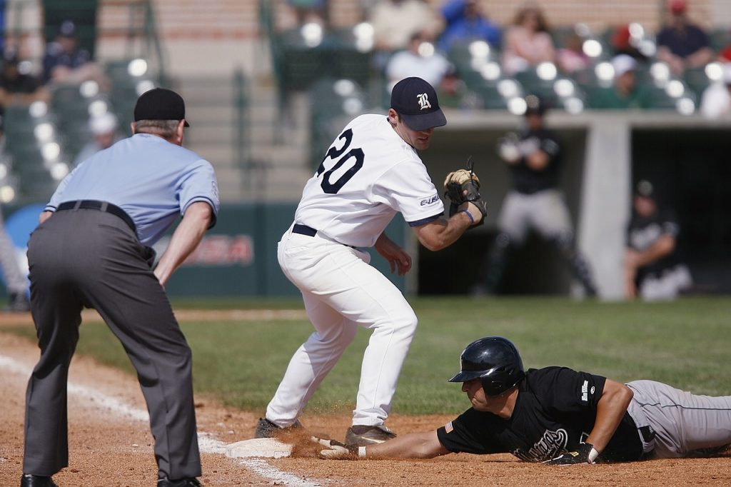 A baseball infielder out of position to make a play on a diving base-runner, illustrating the non-optimal results of typical budgeting systems.
