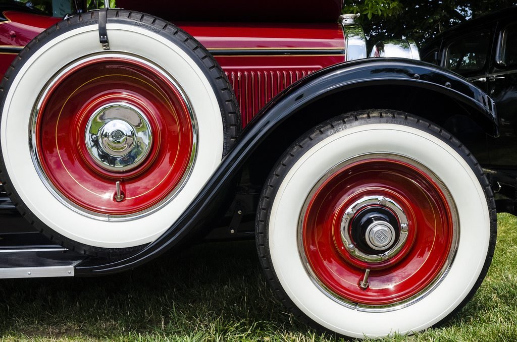A close-up of a fender-mounted spare tire on a classic Hupmobile, illustrating the similarities between a spare tire and an emergency fund.
