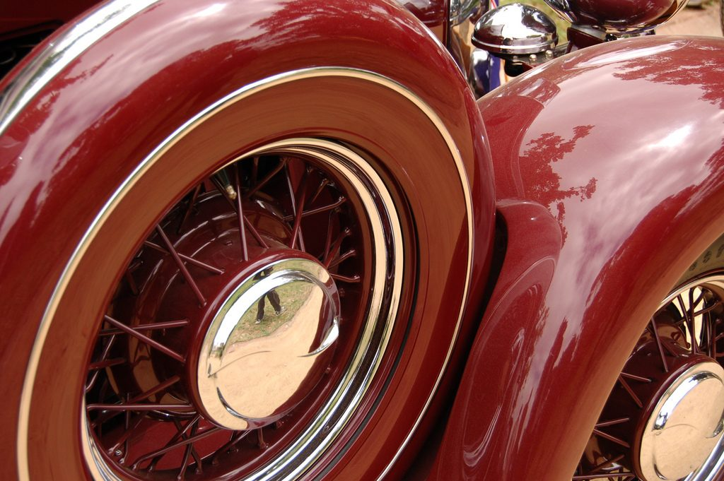 A close-up of a fender-mounted spare tire on a classic Hupmobile, illustrating the need to size your emergency fund appropriately.