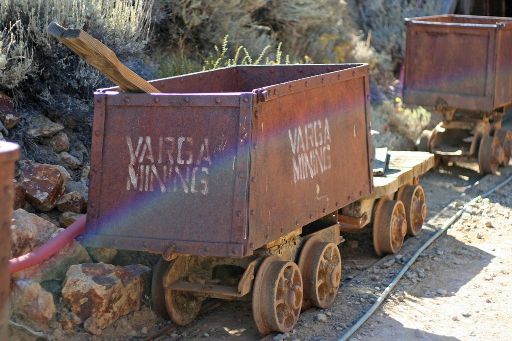 A mining cart on rails, illustrating the potential wealth made possible by mining your debt with extra payments.