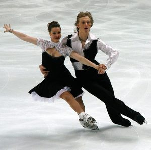 An olympic couple figure skating, illustrating the need for choreography in the cash flow of every monthly budget.