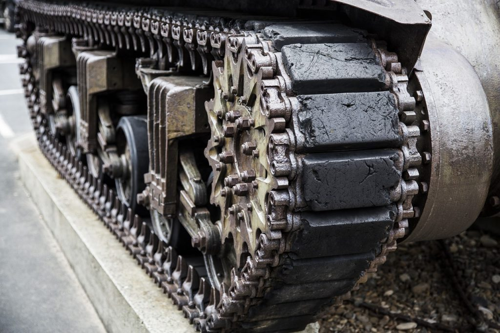Close-up of the track on an army tank, symbolizing the benefits of creating a heavily-armored budget.