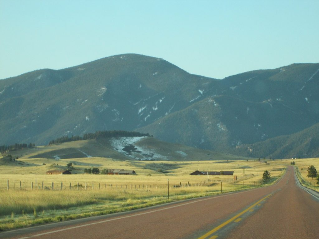 Road winding through the foothills of the Bighorn Mountains.