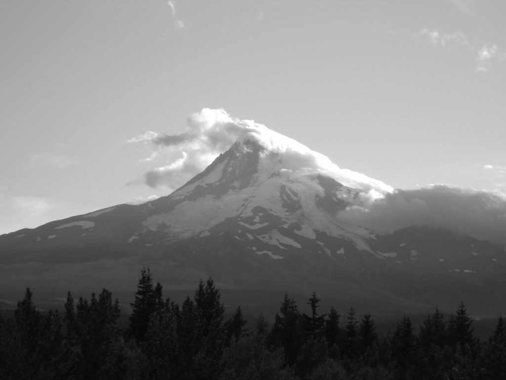 Clouds spilling over the peak of Oregon's Mt. Hood.
