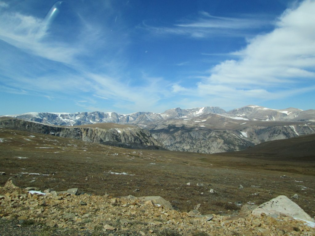 View of alpine country and low-hanging clouds on top of Beartooth Pass.