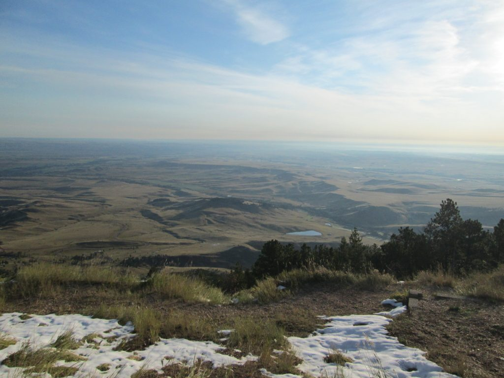 Sun-carpeted early-morning view of Eastern Wyoming from the Bighorn Mountains