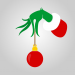 A Christmas ornament held aloft by the fuzzy, green fingers of The Grinch.